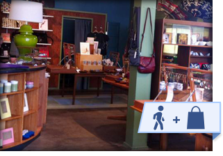 local boutique store interior with walk and shop local banner